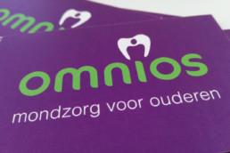 logo Omnios op visitekaartjes